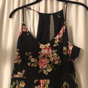 Adorable floral Maxi dress with side cutouts.